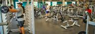 Squat rack and other free weight equipment in the wellness center of the Princess Anne Family YMCA