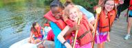 kids playing around kayaks