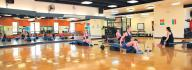 people working out in group exercise class