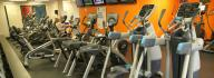 Cardio equipment in the wellness center at the Albemarle Family YMCA, including treadmills, bikes, ellipticals and steppers