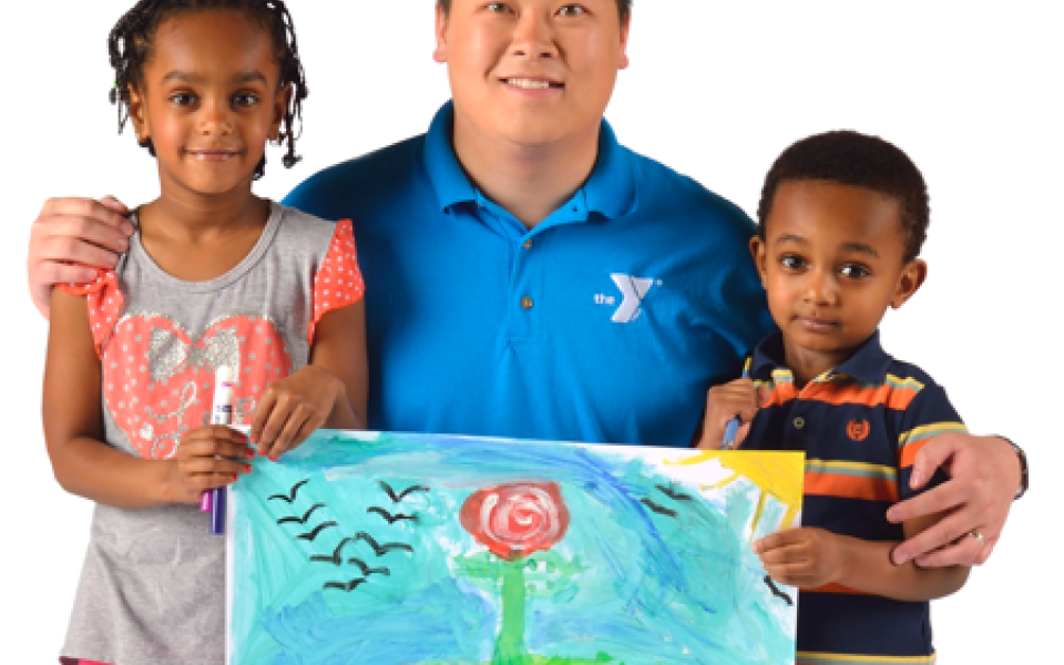 YMCA staff member with two young participants and their painting