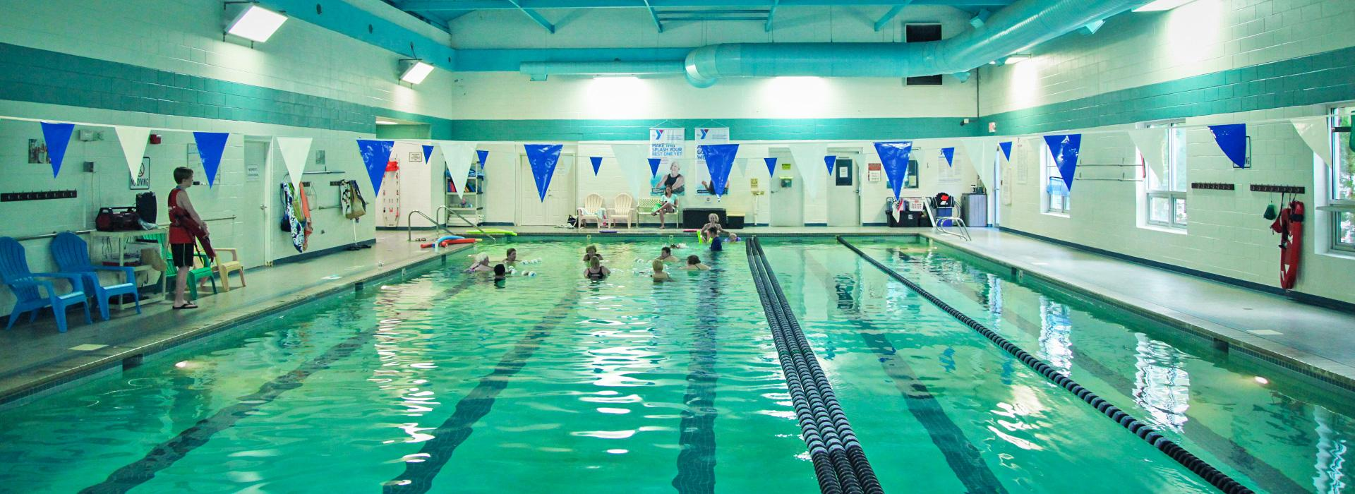Members swimming in the 25-yard indoor lap swimming pool at the Hilltop Family YMCA