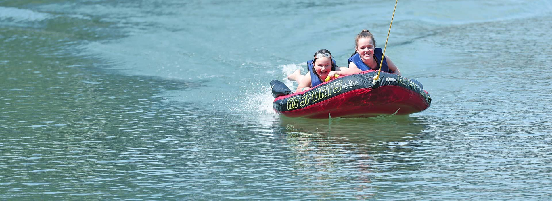 children on inner tube on the water