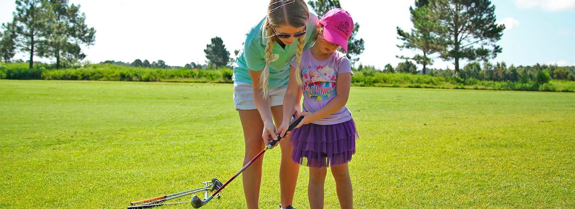 The First Tee of Hampton Roads instructor teaching girl