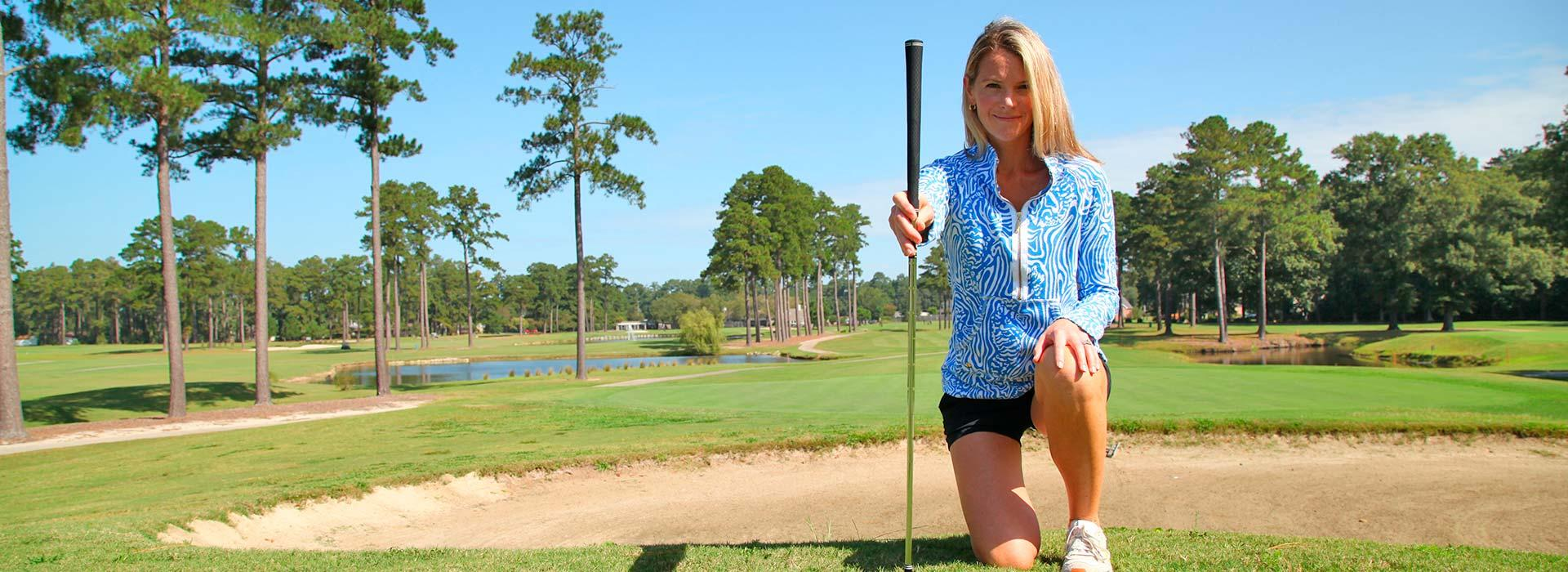 Female golfer posing with club at YMCA of the Pines golf course in Elizabeth City, NC