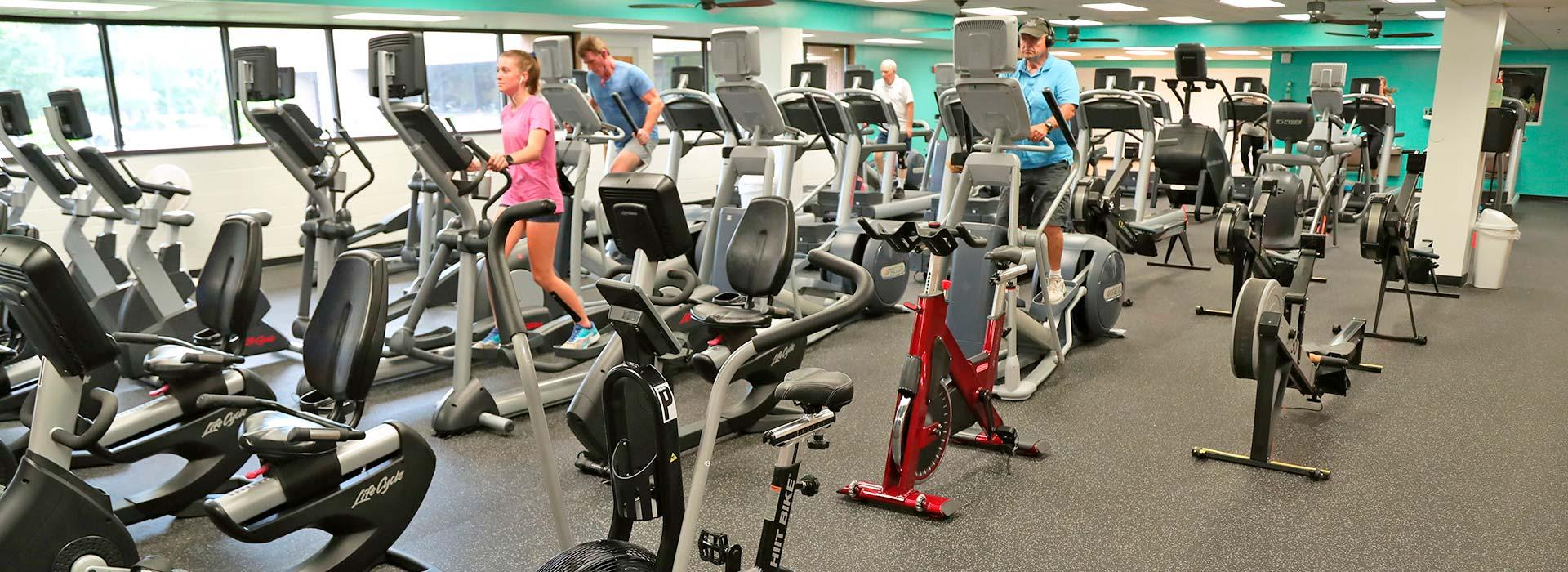 Members using cardio equipment, including treadmills, ellipticals, bikes and steppers at the Portsmouth YMCA