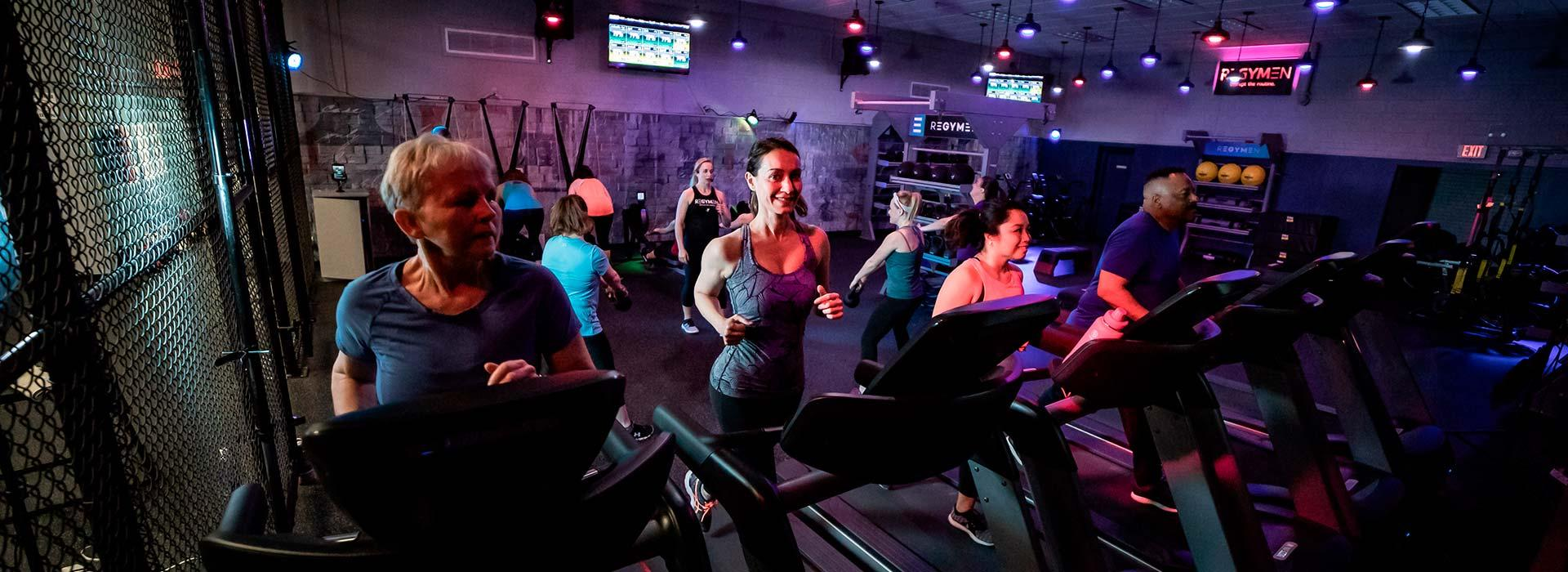 People running on treadmills in REGYMEN fitness workout