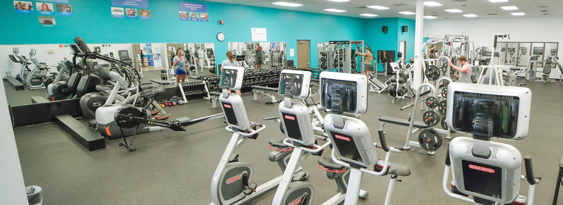 Cardio equipment including bikes, treadmills, steppers and ellipticals in the wellness center at the Hilltop Family YMCA