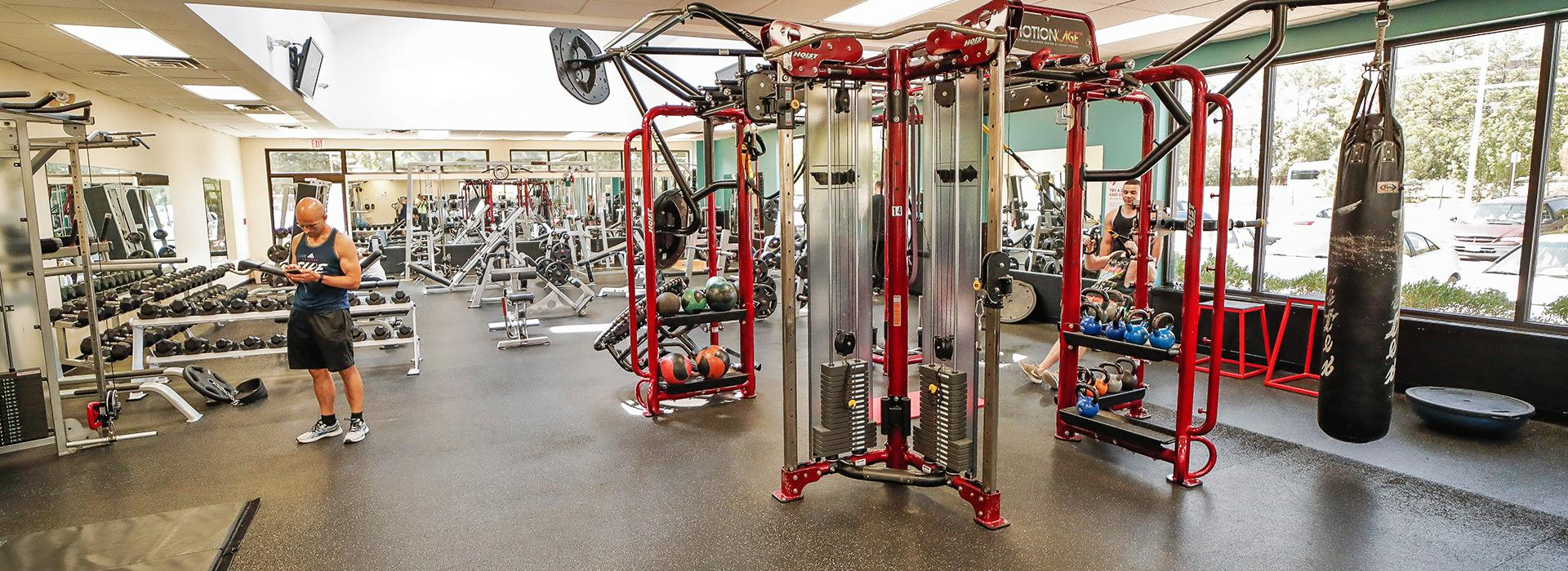 Free weight center at the Mt. Trashmore Family YMCA, including MotionCage, weight benches and racks