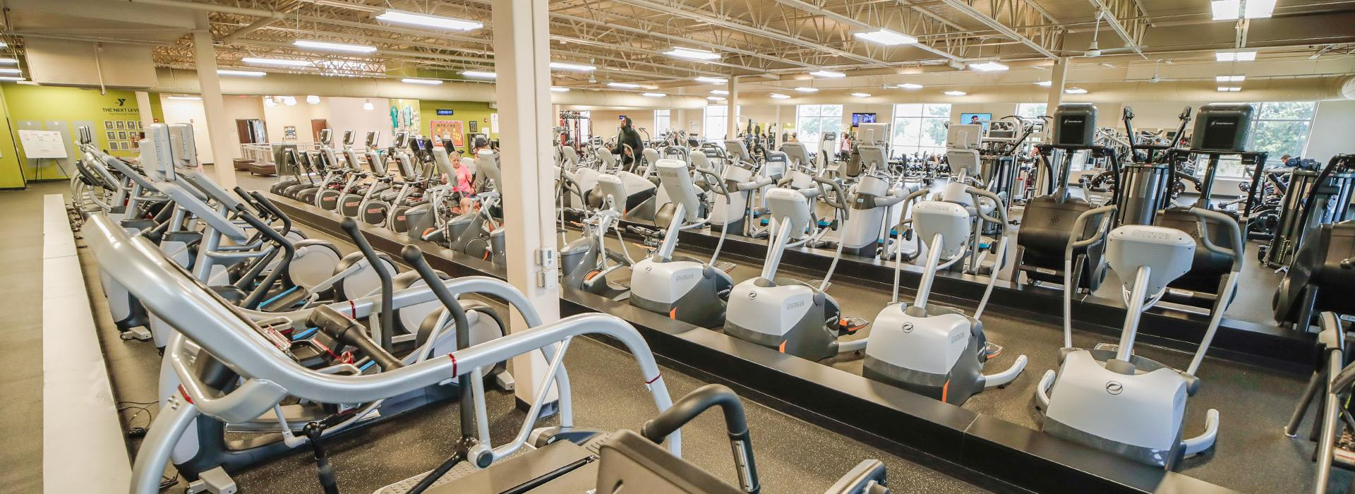 Cardio equipment including treadmills, ellipticals, bikes and steppers in the wellness center at the Princess Anne Family YMCA