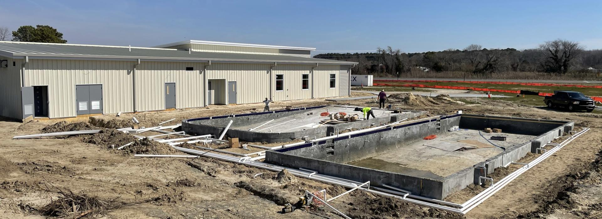 Exterior side view of the Northampton County YMCA with concrete poured for the swimming pools
