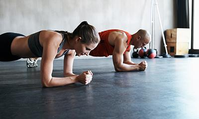 man and woman working on planks