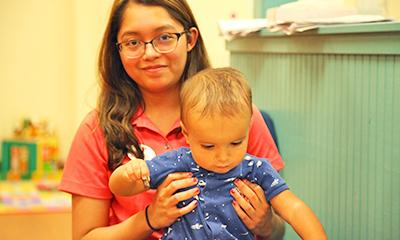 YMCA staff caring for child in daycare