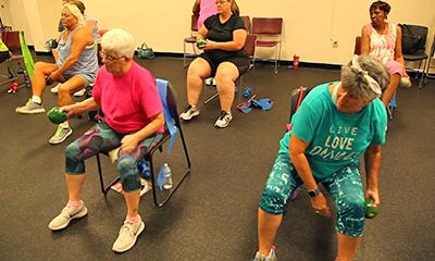 Seniors in chair group exercise class