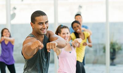 people having fun in a group exercise class