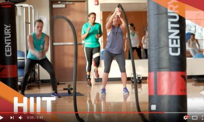 women in group exercise class on the battle ropes