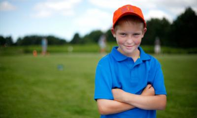 child on golf course